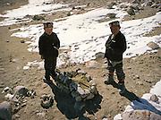 Kids of the Khan playing near what looks like a small tumb. Qyzyl Qorum camp. Afghanistan