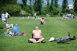 © Licensed to London News Pictures. 07/05/2018. LONDON, UK.  A man sunbathes on the hottest May Bank Holiday on record in Regent's Park.  Photo credit: Stephen Chung/LNP