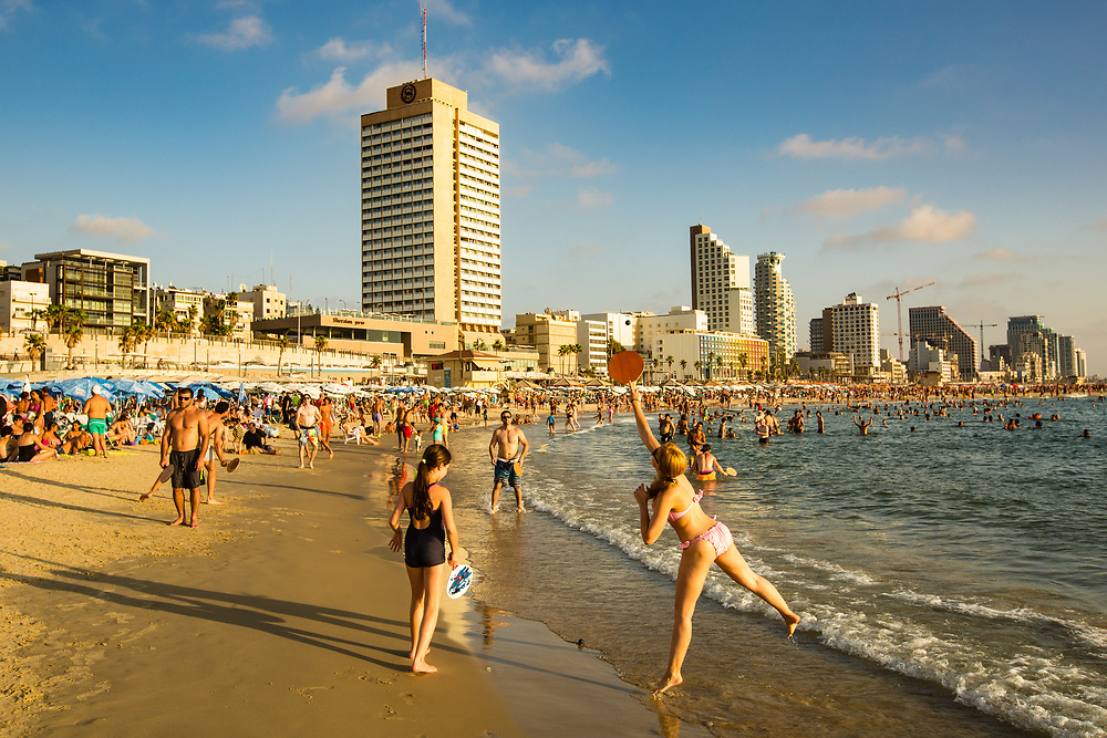 People play Matkot, or paddle ball on Gordon Beach in Tel Aviv's Merkaz Hair neighborhood