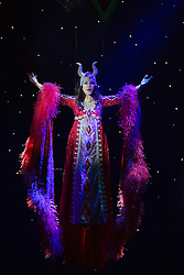 "© Licensed to London News Pictures. 06/12/2012. London, England. Priscilla Presley makes and entry flying on wires. Priscilla Presley as the ""Wicked Queen"". Priscilla Presley makes her pantomime debut in ""Snow White and the Seven Dwarfs"" at the New Wimbledon Theatre, Wimbledon, from 7 December 2012 to 13 January 2013. Warwick Davis and Jarred Christmas star alongside her. Images from the Dress Rehearsal. Photo credit: Bettina Strenske/LNP"