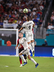 July 31, 2018 - Miami Gardens, Florida, USA - Real Madrid C.F. forward Karim Mostafa Benzema (9) leaps to head the ball during an International Champions Cup match between Real Madrid C.F. and Manchester United F.C. at the Hard Rock Stadium in Miami Gardens, Florida. Manchester United F.C. won the game 2-1. (Credit Image: © Mario Houben via ZUMA Wire)