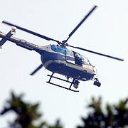 NLD/Huizen/20050906 - Verbrand lijk gevonden langs bospad Bussummerweg Huizen, KLPD politiehelicopter komt foto's maken, Bolkow