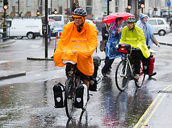 © Licensed to London News Pictures. 24/09/2012. LONDON, UK. Members of the public attempt to stay dry in central London today (24/09/12). Rain and strong winds today hit the UK causing widespread disruption with gusts of up to 60mph predicted for the north of England and up to 80mm of rain predicted in some areas.. Photo credit: Matt Cetti-Roberts/LNP