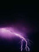 Lightning striking the Painted Desert, Petrified Forest National Park, Arizona.