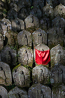 Jizo at Senyuji - Senyuji Temple is No. 58 on the Shikoku pilgrimage and one of the more impressively located pilgrimage templesstandingon a hillside 1,300 feet above sea level which means that pilgrims who walk to it have quite a climb. The guardian statues in the gateway below the temple are impressive. Behind the daishi-do is a flight of concrete steps which leads up into the hill behind the temple. This path passes through pleasant woods of evergreen and trees including sasa bamboo. It's lined at intervals with attractive Buddhist statues. The path leads to a hilltop with panoramic views of Imabari, the Shimanami-Kaido suspension bridge and the Seto Inland Sea. For this walk, sensible shoes are a must. Sadly In 1947, all of the buildings built by Kobo Daishi between810-824 burned down in a forest fire. They were rebuilt from 1953. Senyu-ji is one of six pilgrimage temples located relatively close together in Imabari.