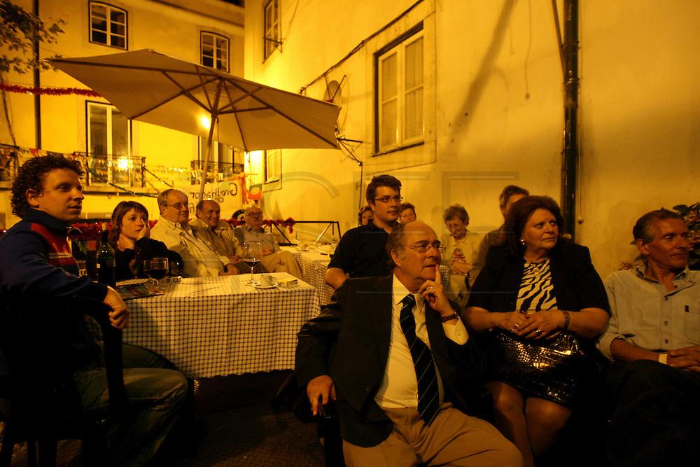 "Audience at the esplanade of restaurant ""Mesa de Frades"", an old chapel in Alfama typical neighborhood"