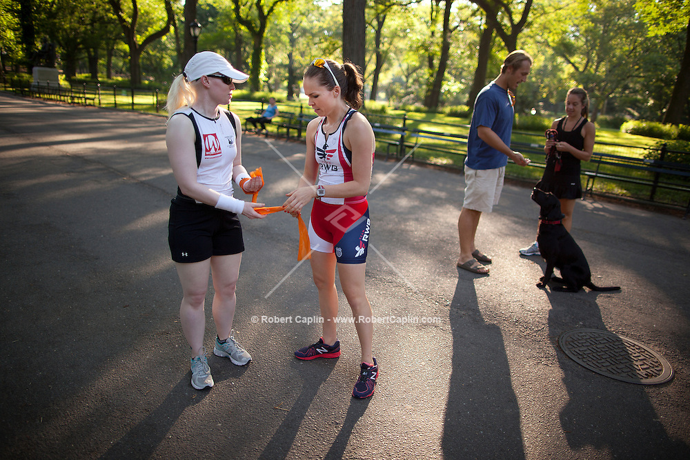Caroline Gaynor helps blind athletes compete in triathlons. Leona Emberson, in blue from Ottawa, trains with Gaynor in Central Park for the New York City Triathlon.  .. Photo by Robert Caplin