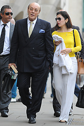 © Licensed to London News Pictures. FILE PIC DATED 15/08/2012. London,UK.Cypriot businessman Asil Nadir arriving at The Old Bailey, in London with his wife Nur Nadir on August 15, 2012. Asil Nadir, who fled to Cyprus in 1993 after the charges were first brought, is accused of £34m fraud at his firm Polly Peck .  Photo credit : Thomas Campean/LNP