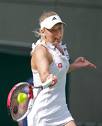 21.06.2011, Wimbledon, London, GBR, Wimbledon Tennis Championships, im Bild Caroline Wozniacki (DEN) in action during the Ladies' Singles 1st Round match on day two of the Wimbledon Lawn Tennis Championships at the All England Lawn Tennis and Croquet Club, EXPA Pictures © 2011, PhotoCredit: EXPA/ Propaganda/ *** ATTENTION *** UK OUT!