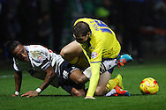Neil Danns of Bolton Wanderers and Grant Holt of Huddersfield Town (r) get tangled up. Skybet football league championship match, Bolton Wanderers v Huddersfield Town at the Macron stadium in Bolton, Lancs on Saturday 29th November 2014.<br /> pic by Chris Stading, Andrew Orchard sports photography.