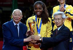 01-09-2013 VOLLEYBAL: WORLD GRAND PRIX FINAL6 AWARDING: SAPPORO<br /> Brazil s team gold medal with Mr. Jizhong Wei, FIVB Honory Life President and Mr. Tatsuo Kondo, Hokkaido Volleyball Association President.<br /> ©2013-FotoHoogendoorn.nl
