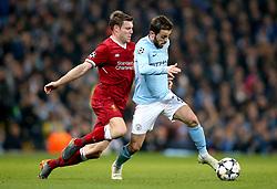Liverpool's James Milner (left) and Manchester City's Bernardo Silva battle for the ball