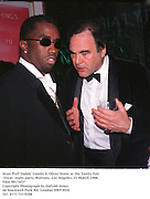 Sean 'Puff Daddy' Combs & Oliver Stone at the Vanity Fair Oscar  night party, Mortons, Los Angeles. 23 March 1988. Film 98174f27<br />
