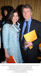 KIMBERLEY FORTIER publisher of The Spectator and her husband MR STEPHEN QUINN, at a reception in London on 24th April 2003.PJA 52