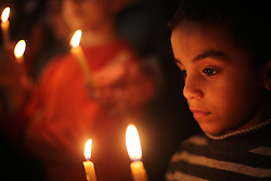 April 14, 2017 - Gaza City, Gaza Strip - Supporters of the Palestinian Hamas movement hold placards and light candles during a protest against the Israeli blockade of the Gaza Strip.  (Credit Image: © Mohammed Asad/APA Images via ZUMA Wire)