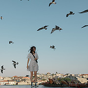 Rooftop views of the Eminonu, with seagulls flying around.
