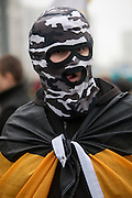Moscow, Russia, 04/11/2010..A masked demonstrator wrapped in a Russian nationalist flag, one of some 7,000 from the Movement Against Illegal Immigration and other ultra-nationalist groups as they march in Moscow. The demonstration, called the Russian March, was organised to mark the National Unity Day holiday, which has replaced the old holiday celebrating the Bolshevik Revolution, and which extremist nationalist groups have tried to make their own.