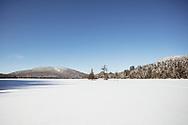snowy bluebird day on Mckensie Pond outside of Saranac Lake in the Adirondack Park