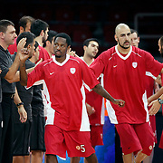 Olympiacos's Kalin LUCAS (C) and Pero ANTIC (R) during their Two Nations Cup basketball match Anadolu Efes between Olympiacos at Abdi Ipekci Arena in Istanbul Turkey on Sunday 02 October 2011. Photo by TURKPIX