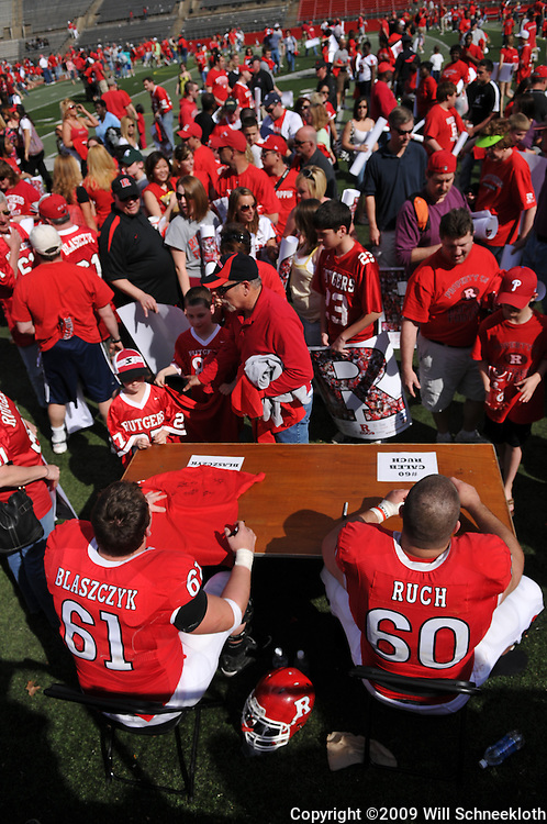 Apr 18, 2009; Piscataway, NJ, USA; Rutgers OL Ryan Blaszczyk (61) and Caleb Ruch (60) sign autographs for fans following Rutgers' Scarlet and White spring football scrimmage.