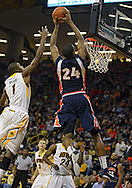 December 29 2010: Illinois Fighting Illini forward Mike Davis (24) dunks the ball as Iowa Hawkeyes forward Melsahn Basabe (1) defends during the second half of an NCAA college basketball game at Carver-Hawkeye Arena in Iowa City, Iowa on December 29, 2010. Illinois defeated Iowa 87-77.