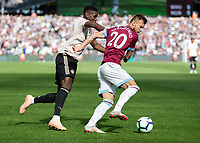 Football - 2018 / 2019 Premier League - West Ham United vs. Manchester United<br /> <br /> Paul Pogba (Manchester United) attempts to pull back Andriy Yarmolenko (West Ham United) at the London Stadium<br /> <br /> COLORSPORT/DANIEL BEARHAM