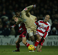 Photo: Aidan Ellis.<br /> Doncaster Rovers v Bristol City. Coca Cola League 1.<br /> 26/11/2005.<br /> Bristol's Baz Savage is brought down by Doncaster's Stephen Roberts and Ricky Ravenhill