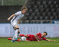 Swansea City's Conor Gallagher (left) is tackled by Bristol City's Jamie Paterson (right) <br /> <br /> Photographer David Horton/CameraSport<br /> <br /> The EFL Sky Bet Championship - Swansea City v Bristol City- Saturday 18th July 2020 - Liberty Stadium - Swansea<br /> <br /> World Copyright © 2019 CameraSport. All rights reserved. 43 Linden Ave. Countesthorpe. Leicester. England. LE8 5PG - Tel: +44 (0) 116 277 4147 - admin@camerasport.com - www.camerasport.com