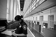Lt Christine Botelho fills in the log book as she prepares to do lockk down.  The Bristol County Jail & House of Correction located on Ash Street in New Bedford, Massachusetts was started in 1829, and is the oldest running jail in the United States.   The Ash street jail, as it is known, has been a controversial facility since it opened.  It is believed to be the site of the last pubic hanging in Massachusetts sometime in the 1890's.  Two big riots broke out in the 90's (1993, 1998) and since then the facility has been modified to alleviate some of the crowded conditions that resulted in the riots.