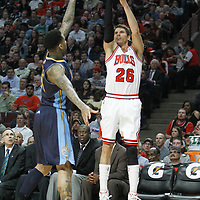 26 March 2012: Chicago Bulls shooting guard Kyle Korver (26) takes a three point jumpshot during the Denver Nuggets 108-91 victory over the Chicago Bulls at the United Center, Chicago, Illinois, USA. NOTE TO USER: User expressly acknowledges and agrees that, by downloading and or using this photograph, User is consenting to the terms and conditions of the Getty Images License Agreement. Mandatory Credit: 2012 NBAE (Photo by Chris Elise/NBAE via Getty Images)