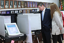 Secretary of State Brian Kemp, Republican candidate for Georgia governor, with his daughter Amy Porter, casts his vote at the Winterville Train Depot on Tuesday, Nov. 6, 2018, in Winterville, Ga. Photo by Curtis Compton/Atlanta Journal-Constitution/TNS/ABACAPRESS.COM