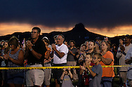 People applaud at a prayer vigil ceremony for the 19 firefighters killed in a nearby wildfire in Prescott, Arizona July 2, 2013. REUTERS/Rick Wilking (UNITED STATES)