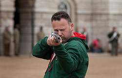 © Licensed to London News Pictures. 12/06/2012. LONDON, UK. A reenactor of the 'Moscow Militia' aims his musket during a dress rehearsal ahead of the annual Beating Retreat ceremony on Horse Guard's Parade today (12/06/12). Photo credit: Matt Cetti-Roberts/LNP