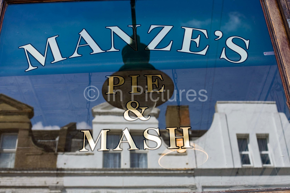 Manze's Eel, Pie and Mash shop in Walthamstow, East London, UK.Although the shop still trades under the original Manze name, it is now independently owned and no longer part of the Manze family.Eel, pie and mash shops are a traditional but dying business. Changing tastes and the scarcity of the eel has meant that the number of shops selling this traditional working class food has declined to just a handful mostly in east London. The shops were originally owned by one or two families with the earliest recorded, Manze's on Tower Bridge Road being the oldest surviving dating from 1908. Generally eels are sold cold and jellied and the meat pie and mash potato covered in a green sauce called liquor.