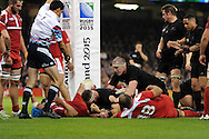 Kieran Reed of New Zealand (c)goes under the posts to score a try in 2nd half. Rugby World Cup 2015 pool c match, New Zealand v Georgia at the Millennium Stadium in Cardiff, South Wales  on Friday 2nd October 2015.<br /> pic by  Andrew Orchard, Andrew Orchard sports photography.