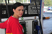 A female petrol station attendant