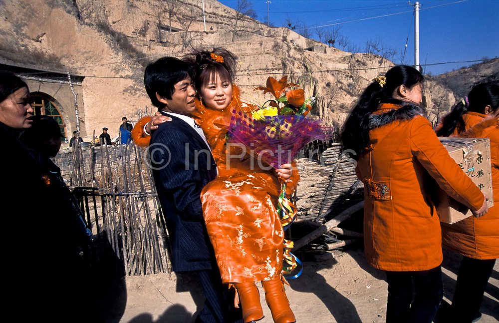 Bride Ai Xia is picked up by Groom Liu Xiao Ning leaving her cave home in Chang Qu village,  for a new life, Shaanxi, China