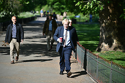 © Licensed to London News Pictures. 09/05/2020. London, UK. Prime Minister Boris Johnson walks in St James' Park. The government is set to announce measures to ease lockdown, which was introduced to fight the spread of the COVID-19 strain of coronavirus. Photo credit: Ben Cawthra/LNP