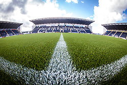 The three stands from the half-way line with the new plastic pitch. The Falkirk Stadium, for the Scottish Championship game v Morton. The woven GreenFields MX synthetic turf and the surface has been specifically designed for football with 50mm tufts compared with the longer 65mm which has been used for mixed football and rugby uses.  It is fully FFA two star compliant and conforms to rules laid out by the SPL and SFL.<br /> ©Michael Schofield.