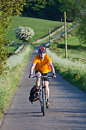 Cyclist on a quiet country lane from Hognaston to Kirk Ireton, Derbyshire