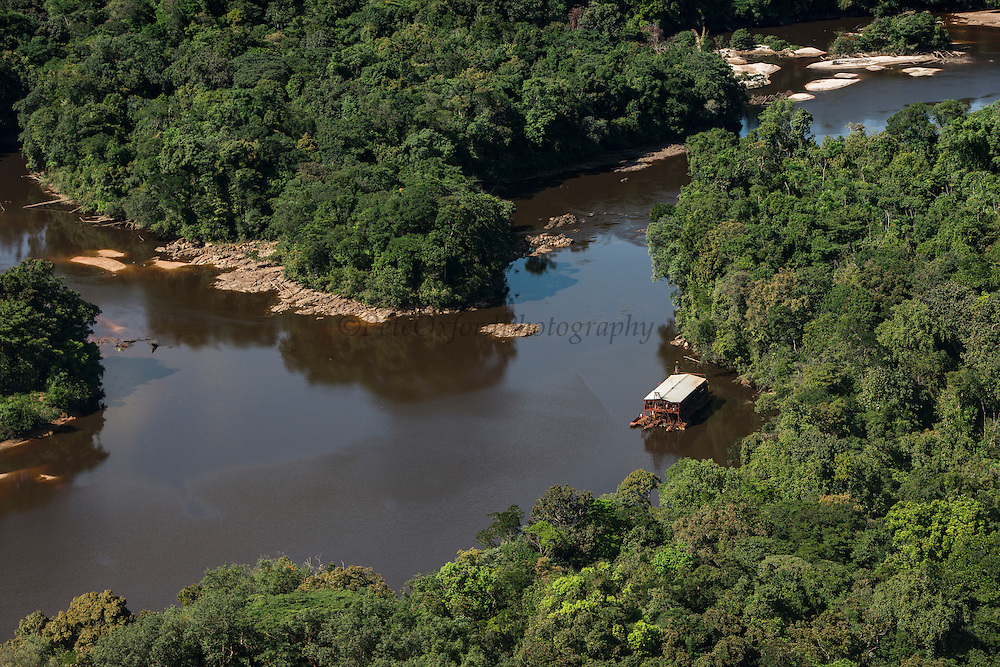 Gold dredger in Kaieteur Gorge<br /> Kaieteur Falls<br /> GUYANA<br /> South America<br /> Kaieteur Falls is the world's widest single drop waterfall, located on the Potaro River in the Kaieteur National Park, in Essequibo, Guyana,<br /> Height: 741′<br /> Elevation: 1,581′<br /> Number of drops: 1<br /> Longest drop: 741′<br /> Watercourse: Potaro River