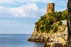 Touching the past in Italy. a defensive rampart stands guard at the edge of the Tyrrhenian Sea, many built by the Etruscans to watch for then fight Saracen pirates who evolved over centuries into the Barbary corsairs. The Royal Clipper under sail beyond also helps keep history living into today.