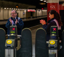 © Licensed to London News Pictures. 28/04/2020. London, UK. Staff at Victoria Station in Westminster clap for fallen key workers after the 1 minute silence next to the Gatwick Express entrance. UK holds a minute silence for key workers who have died in the coronavirus pandemic as the Office for National Statistics reveals there were 1000s of more deaths due to Covid-19 outside of hospitals as the coronavirus pandemic crisis continues. Photo credit: Alex Lentati/LNP
