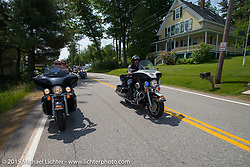 Bentley Warren and Lisa Zatalava ride alongside a Laconia Motorcop from the Laconia Motorcycle Week headquarters in Weirs Beach, NH to Bentley's Saloon in Arundel, Maine. USA. June 17, 2014.  Photography ©2014 Michael Lichter.