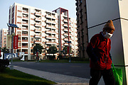 A resident walks out of the Cherish-Yearn retirement community on the outskirts of Shanghai, China, on Tuesday, Dec. 13, 2011. China has about  36000 institutions and 2.7 million beds serving the elderly, enough for 1.6 percent of the population over 60, according to the World Bank.