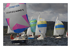 Sailing - The 2007 Bell Lawrie Scottish Series hosted by the Clyde Cruising Club, Tarbert, Loch Fyne..Day 2 racing with light to medium winds from the North west..Sonata Fleet with GBR8718 Dark'n'Stormy in the foreground..