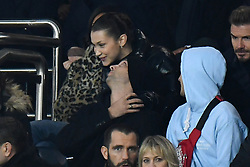 Bella Hadid cuddles an unidentified friend as watching the UEFA Champions League Round of 16 Second Leg Paris Saint-Germain (PSG) v Real Madrid match at Parc des Princes stadium on March 6, 2018 in Paris, France. Photo by Laurent Zabulon/ABACAPRESS.COM