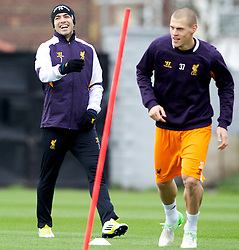 LIVERPOOL, ENGLAND - Wednesday, November 7, 2012: Liverpool's Luis Alberto Suarez Diaz and Martin Skrtel during a training session at the club's Melwood Training Ground ahead of the UEFA Europa League Group A match against FC Anji Makhachkala. (Pic by Vegard Grott/Propaganda)