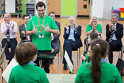 © Licensed to London News Pictures . 27/09/2016 . Liverpool , UK . STEVE ROTHERAM and JEREMY CORBYN visits Faith Primary School in Liverpool , where they listen to and then joins in with the school orchestra . Photo credit : Joel Goodman/LNP