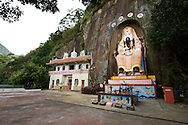 A large starue of a Daoist diety is carved out of a cliff in the Four Beast Mountains in Taipei, Taiwan.